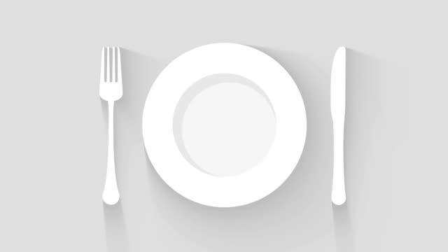 plate, knife and fork place setting motion background - icona posate video stock e b–roll