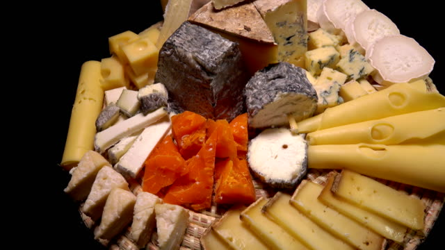 plate of a variety of appetizing french cheeses - cucina francese video stock e b–roll