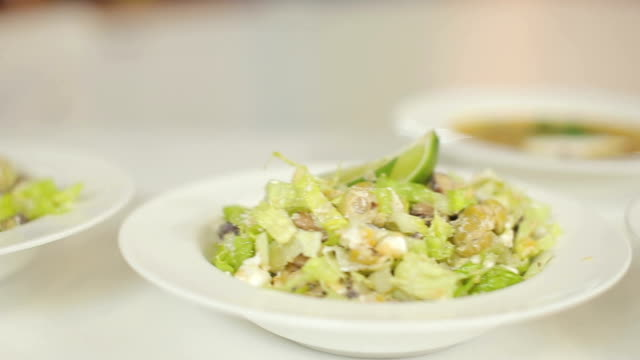 A plate of meat soup and a light summer salad from Peking cabbage. Dolly cam