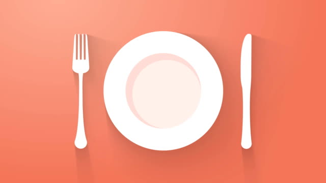 plate with cutlery and long shadows - icona posate video stock e b–roll