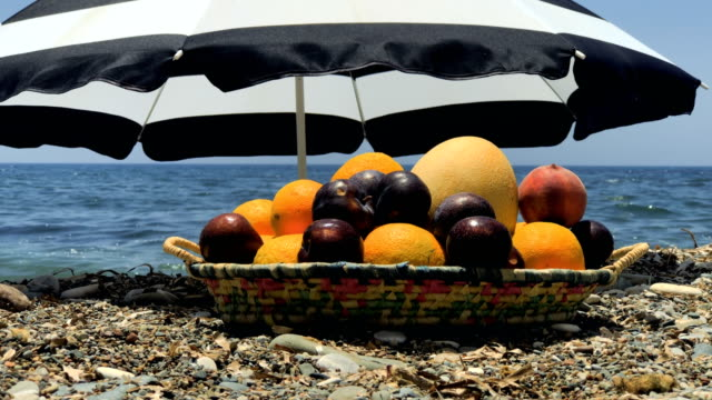 Plate with fruits at sea background video