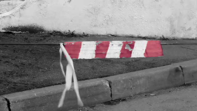 plate with red and white stripes on the clothesline moving in the wind.