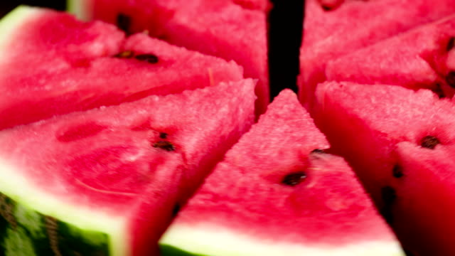 Plate with Slices of Watermelon Video Loops. Triangular slices of watermelon rotate in front of the camera watermelon stock videos & royalty-free footage