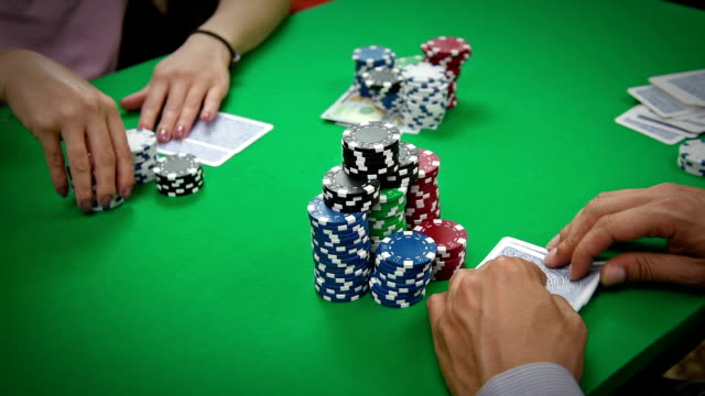 player bets poker player with playing cards and chips at green casino table electron micrograph stock videos & royalty-free footage