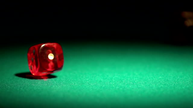 Player throwing red dice on the table, gambling game in video