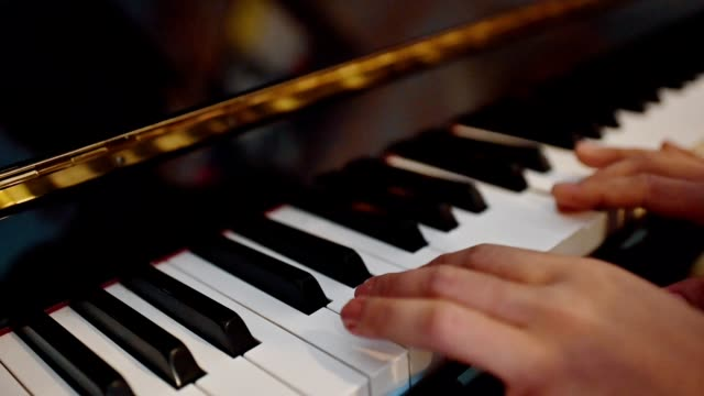 Player with practicing with playing the piano instrumental
