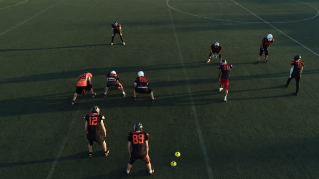 Players on Football practice outdoors