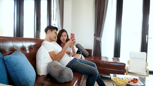 Playful Couple In The Living Room video