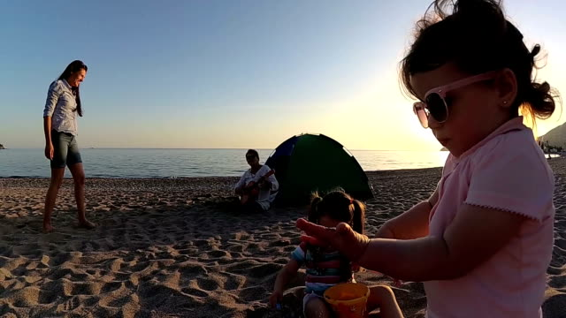 playful extended family having fun on camping on the beach - mika video stock e b–roll