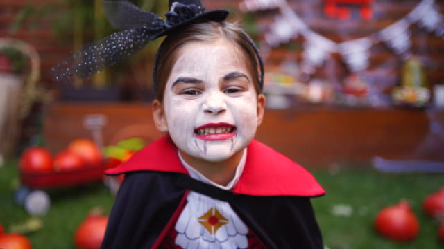 Playful kids enjoying a Halloween party Playful kids enjoying a Halloween party halloween covid stock videos & royalty-free footage