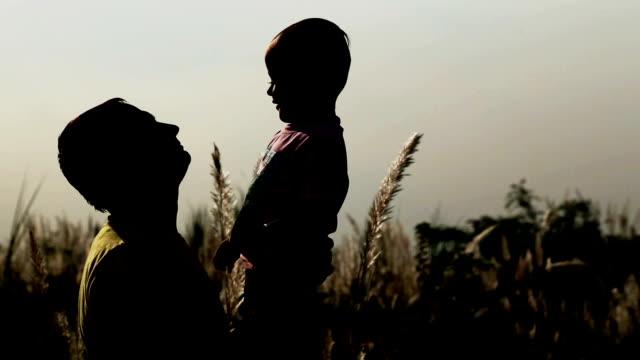 Playful Men & Child Silhouette video