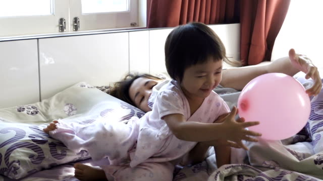 Playful Mother And Daughter In Bedroom video