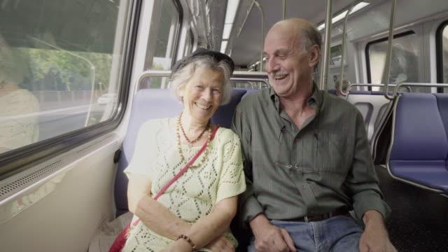 Playful Senior Couple on Subway Train video