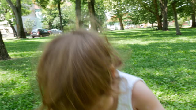 Playful toddler playing in the park Cute playful baby girl having fun in the park in summer hungary stock videos & royalty-free footage