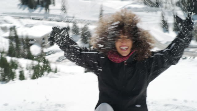 Playful Woman in Winter Mountain Snow - video
