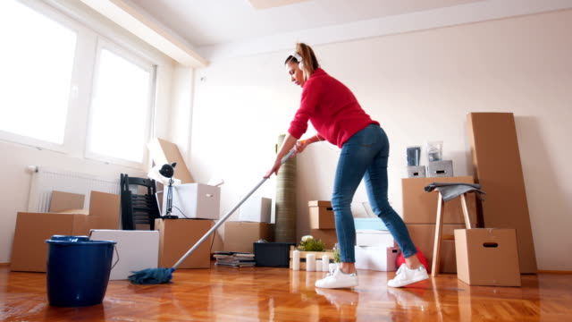 Playful woman mopping the floor There is a one woman, she just bought a new house and she clean the house. 30 39 years stock videos & royalty-free footage
