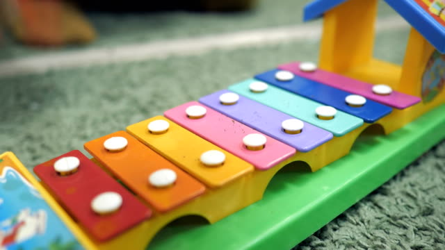playing a colorful xylophone for kid. - banchi scuola video stock e b–roll