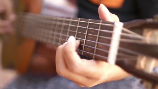 slo mo playing acoustic guitar - classical architecture stock videos & royalty-free footage