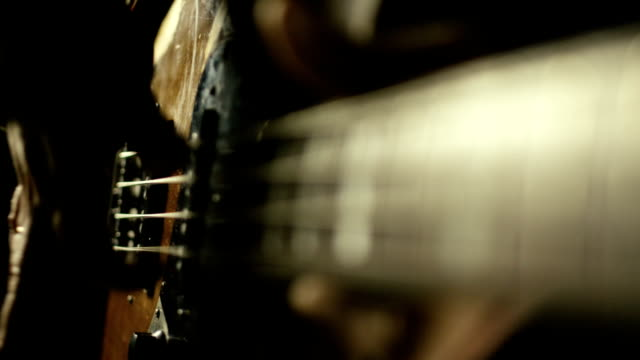 Playing bass guitar in slow motion video