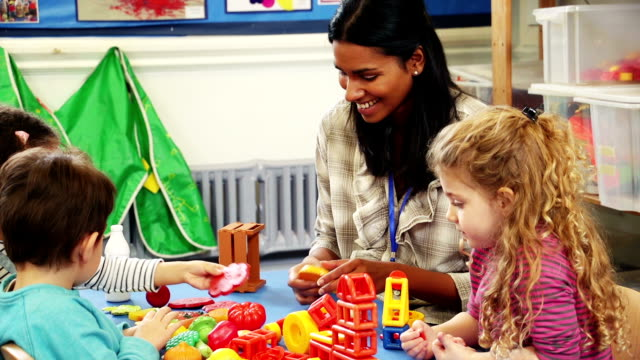 Playing building blocks at nursery video