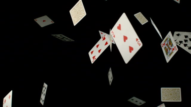 Playing cards falling on black background, Slow Motion video