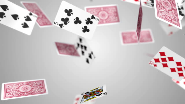Playing cards falling slow motion