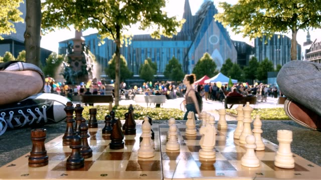 Playing chess on the lawn against the background of Augustusplatz Leipzig video