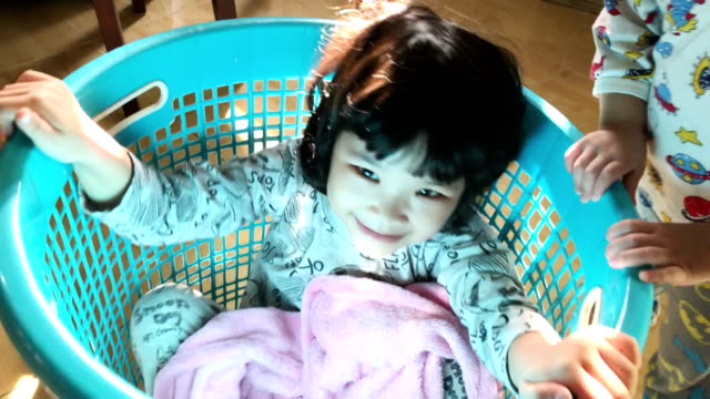 Playing children at home Video 4K of Playing children at home laundry basket stock videos & royalty-free footage
