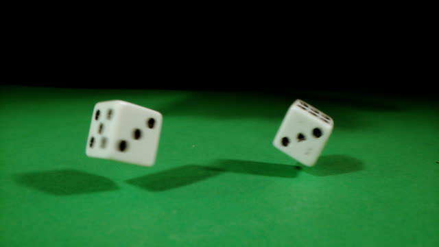 SLO MO Playing dice spinning on a gambling table