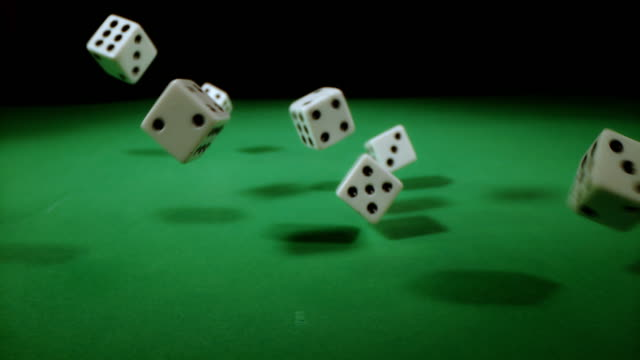 SLO MO Playing dices falling on a gambling table