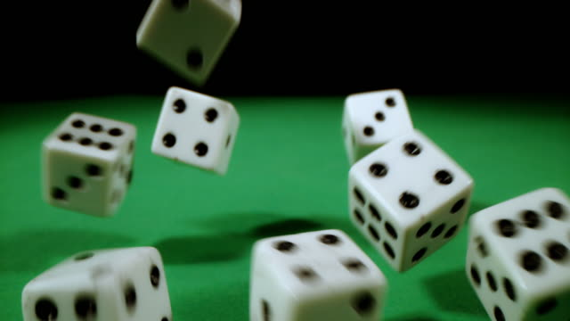 SLO MO Playing dices on a gambling table