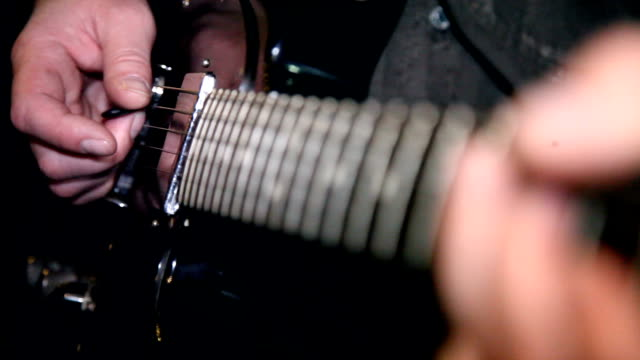 playing eletric guitar close up shot playing an electric guitar with a focus change guitar stock videos & royalty-free footage