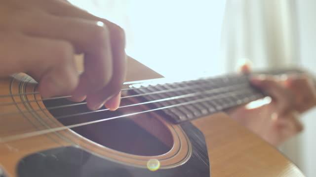 Playing guitar, Close up video