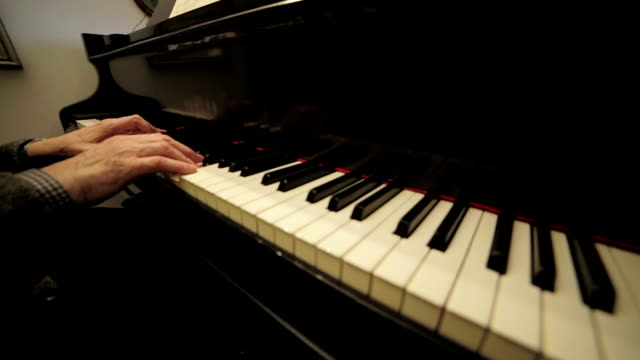 playing on grand piano board: keys, notes, music, musician, classical senior video