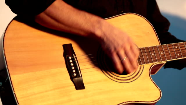 Playing On The Acoustic Guitar. Musical Instrument With Guitarist Hands. Musician In Night Club. video