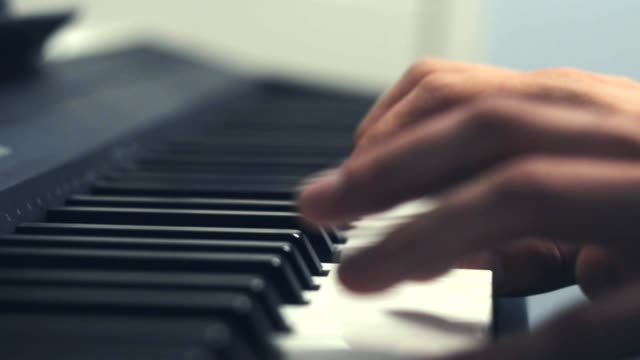 Playing piano. Close Up view
