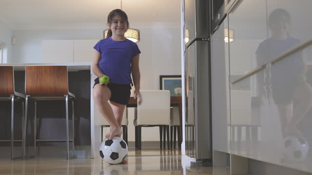 Playing soccer and having an apple