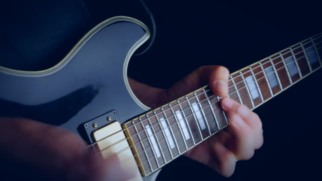 Playing Solo Blues Guitar playing solo blues guitar - vintage colorcorrection guitar stock videos & royalty-free footage