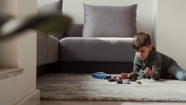 Playing time 6 years old kid is playing with toys in the living room low angle view stock videos & royalty-free footage