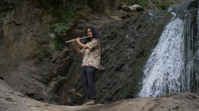 Playing trumpet in a waterfall