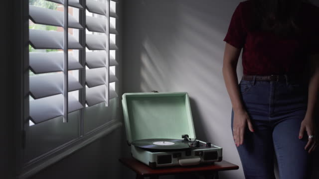 Playing vinyl, tapping to music. video