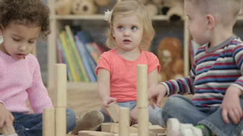 Playing with Blocks Together A group of young children play with blocks together at daycare. art and craft stock videos & royalty-free footage