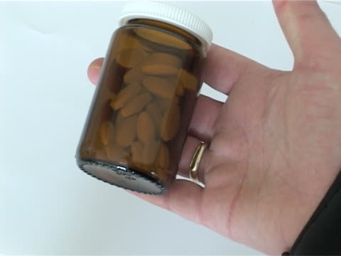 Playing with pills Opening and closing pille bottle pill bottle stock videos & royalty-free footage