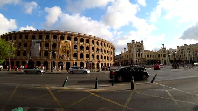 Plaza de Toros Bull fighting arena and city traffic
