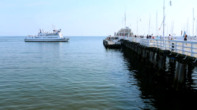 Pleasure boat returning tourists from open sea voyage, summer vacation, travel video