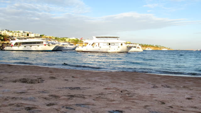 Pleasure Boats Arrive at the Pier on the Beach in Egypt. Time Lapse video