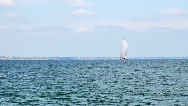 Pleasure yacht makes an excursion along the sea coast