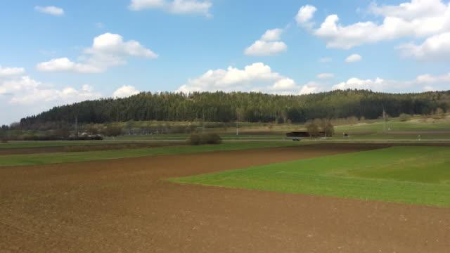 gepflügt und ausgesät, grünes gras teilweise gesät - aerial view soil germany stock-videos und b-roll-filmmaterial
