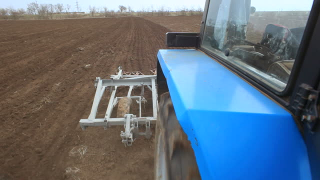 Plowing Field By Agricultural Machinery