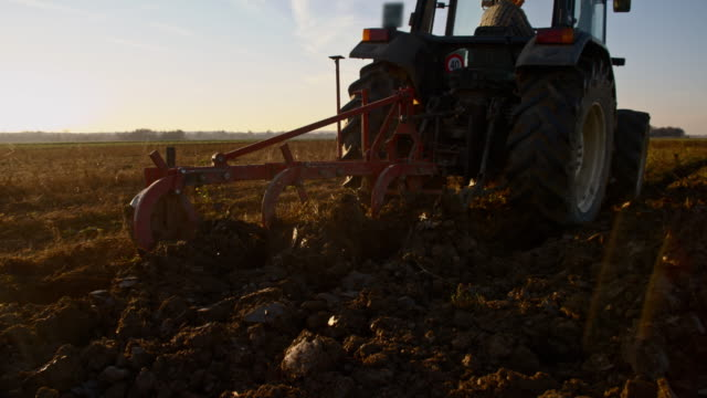 SLO MO Plowing the field with a tractor video